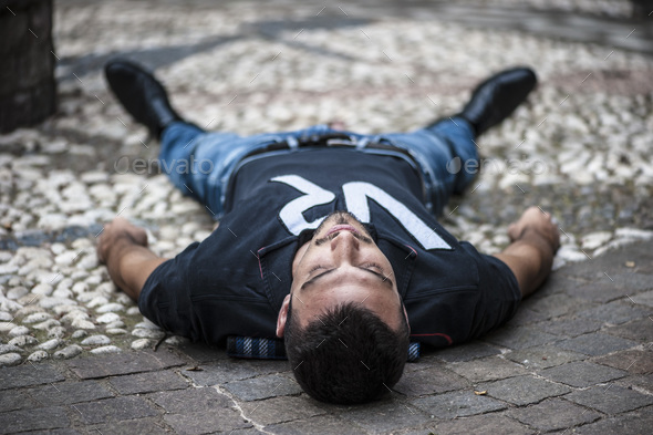 unconscious guy after heart attack in the outdoor - Stock Photo - Images