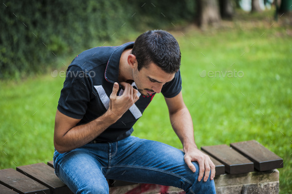 guy having an heart attack - Stock Photo - Images