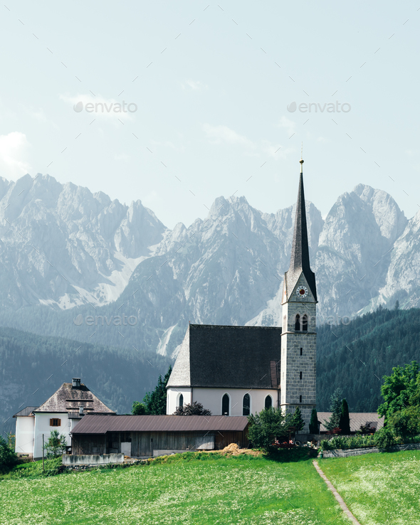 Christianity churh in Gosau village at sunny day. - Stock Photo - Images