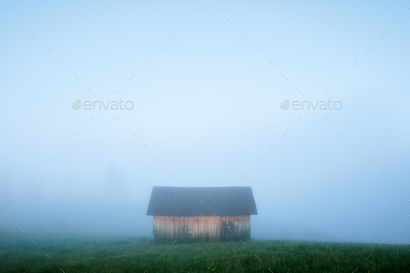 Alone house on foggy meadow - Stock Photo - Images