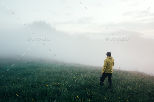 Alone tourist in yellow jacket - Stock Photo - Images