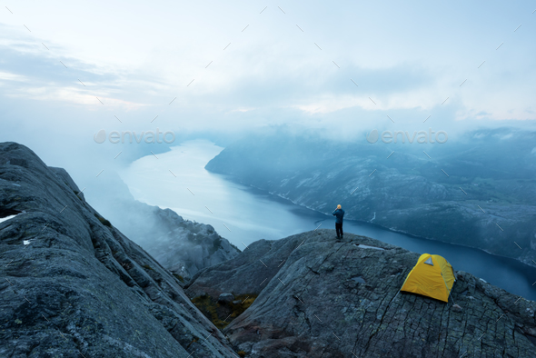 Alone tent on Trolltunga rock - Stock Photo - Images