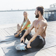 Fit fitness woman and man doing stretching exercises outdoors at city - PhotoDune Item for Sale
