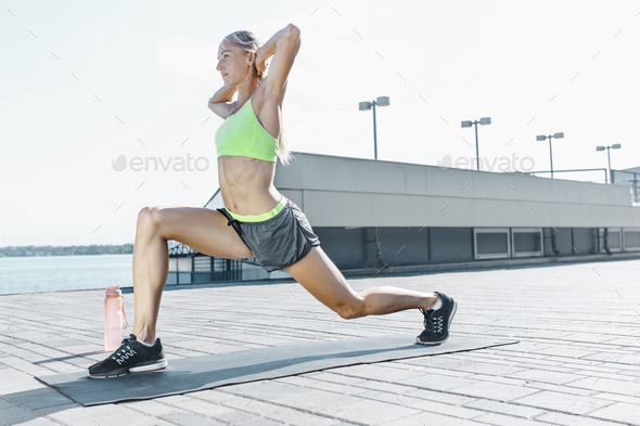 Fit fitness woman doing stretching exercises outdoors at park - Stock Photo - Images