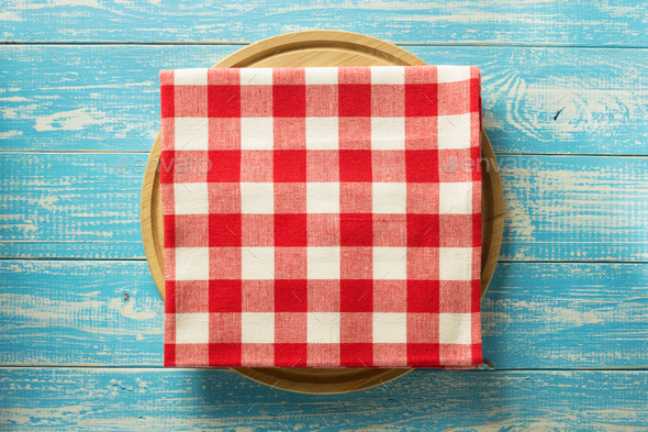 napkin and board on wooden background - Stock Photo - Images