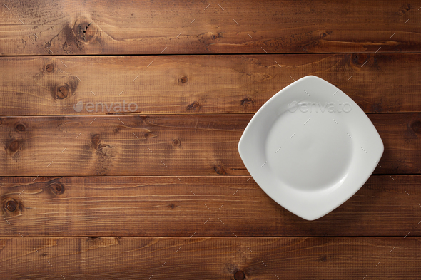 empty plate on wood - Stock Photo - Images