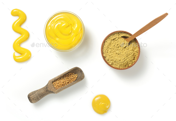mustard sauce in bowl on white background - Stock Photo - Images
