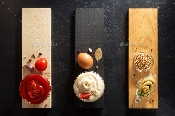 tomato sauce, mayonnaise and mustard in bowl - Stock Photo - Images