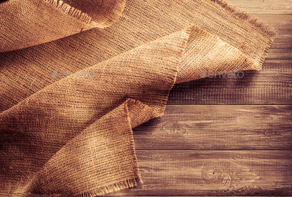 burlap hessian sacking on wood - Stock Photo - Images