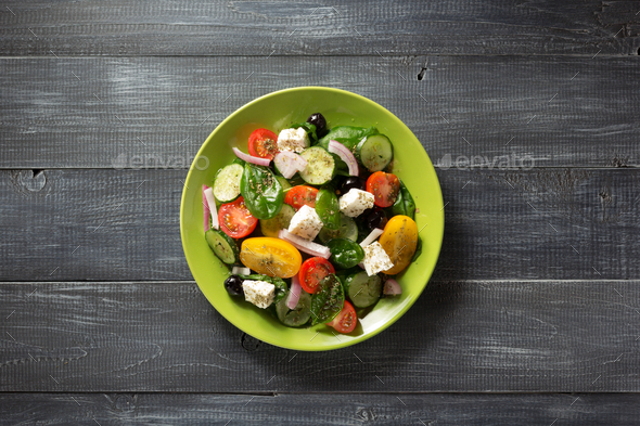 fresh greek salad in plate on wood - Stock Photo - Images