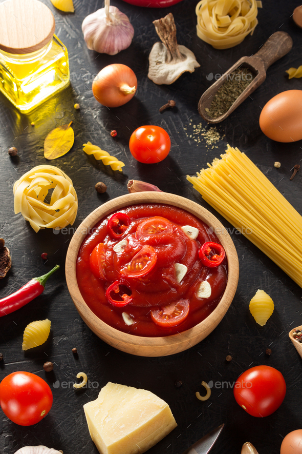 tomato sauce in bowl on black background - Stock Photo - Images