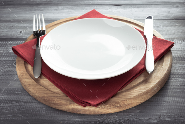 plate, knife and fork on rustic background - Stock Photo - Images