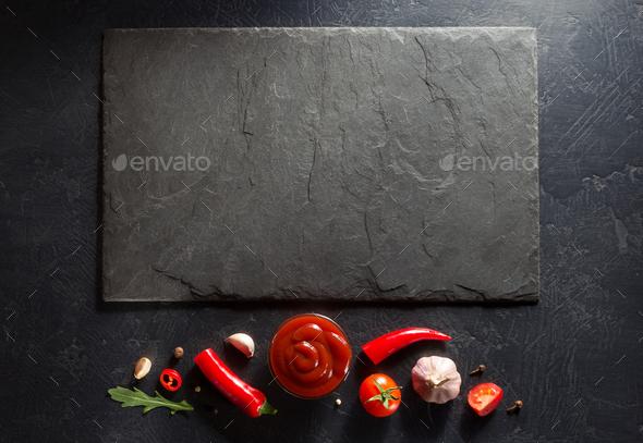 tomato sauce on black background - Stock Photo - Images