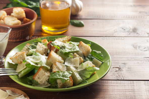caesar salad and ingredients at wood - Stock Photo - Images