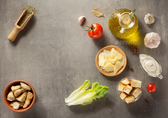 caesar salad ingredients at stone  table - Stock Photo - Images
