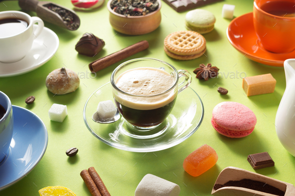 cup and ingredients at green paper - Stock Photo - Images