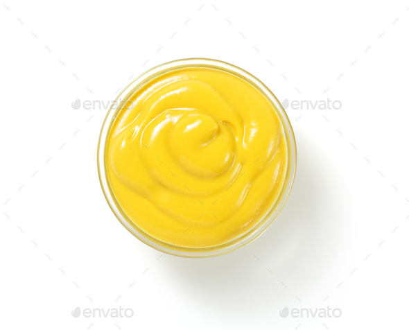 mustard sauce in plate on white background - Stock Photo - Images