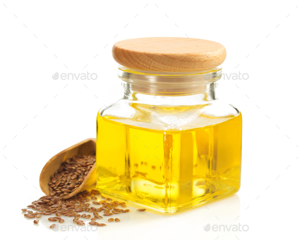 linseed oil in bottle isolated on white - Stock Photo - Images