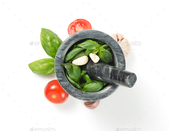 basil in mortar on white background - Stock Photo - Images
