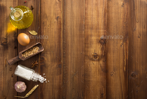 bakery ingredients on wooden background - Stock Photo - Images