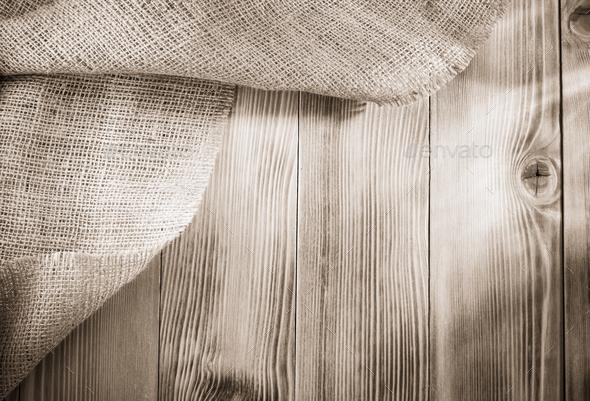 burlap hessian sacking on wood - Stock Photo - Images