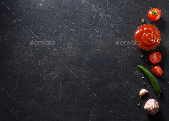 tomato sauce on black background - Stock Photo - Images