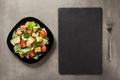 caesar salad in plate at table - PhotoDune Item for Sale