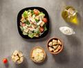 caesar salad and ingredients at table - PhotoDune Item for Sale