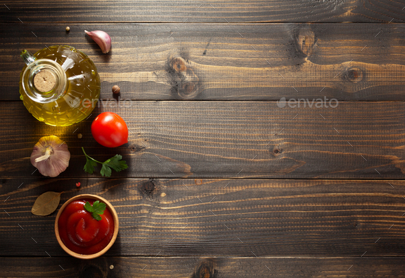 tomato sauce in bowl on wood - Stock Photo - Images