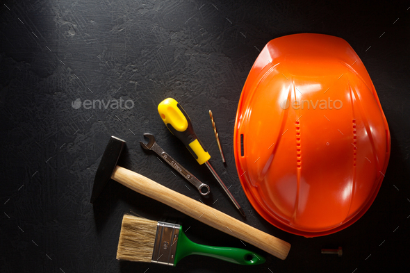 hardhat and tools  on black - Stock Photo - Images