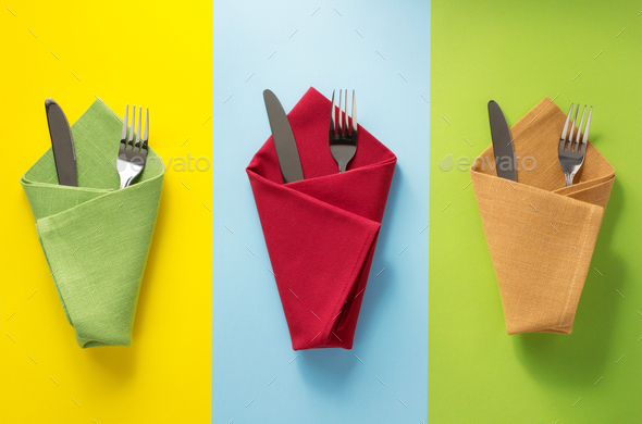 knife and fork at napkin - Stock Photo - Images