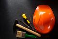 hardhat and tools  on black - PhotoDune Item for Sale