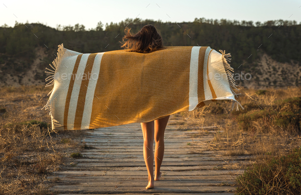 Beautiful woman wrapped in a wool towel - Stock Photo - Images