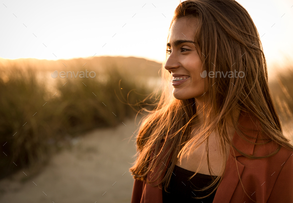 Portrait of a beautiful woman on the beach - Stock Photo - Images