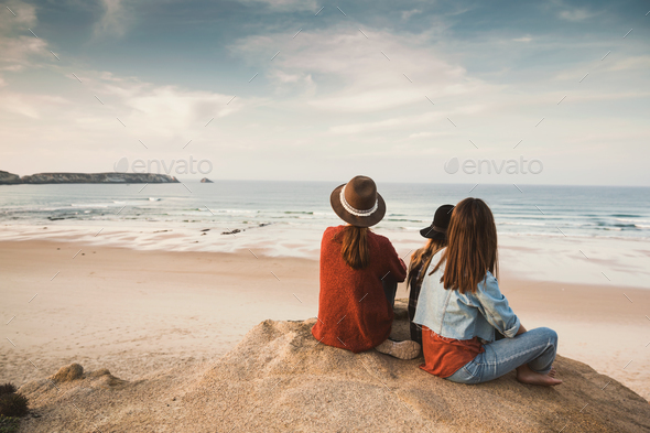 Girs enjoying  a day on the beach - Stock Photo - Images