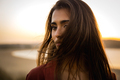 Portrait of a beautiful woman on the beach - PhotoDune Item for Sale