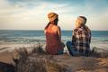 Girls sitting on the beach - PhotoDune Item for Sale