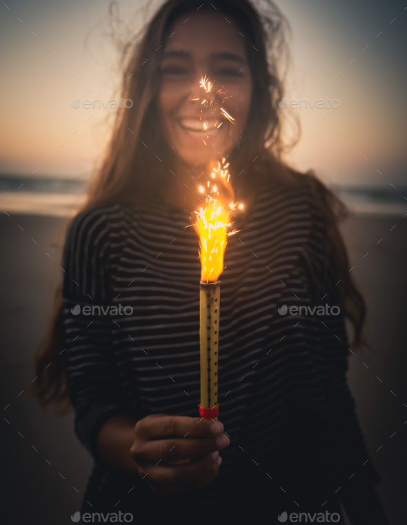 Girl with Fireworks - Stock Photo - Images