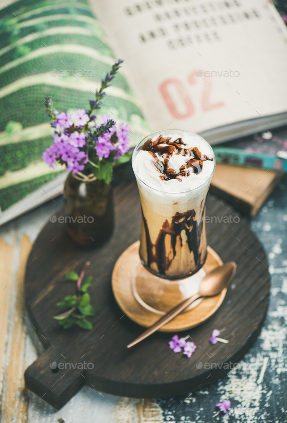 Iced mocha coffee with whipped cream in glass on board - Stock Photo - Images