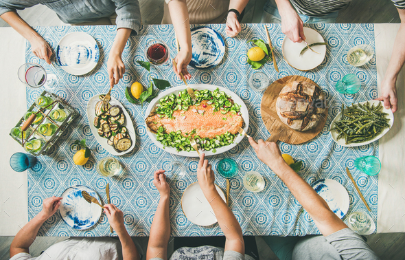 Family or friends having seafood summer dinner - Stock Photo - Images