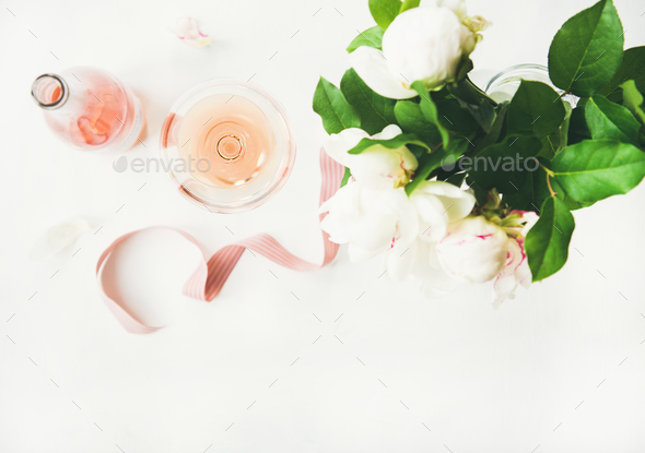 Rose wine and bouquet of peony flowers - Stock Photo - Images