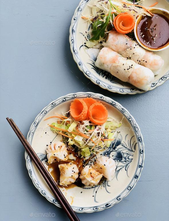 Dim sum dumplings and summer rice paper rolls - Stock Photo - Images
