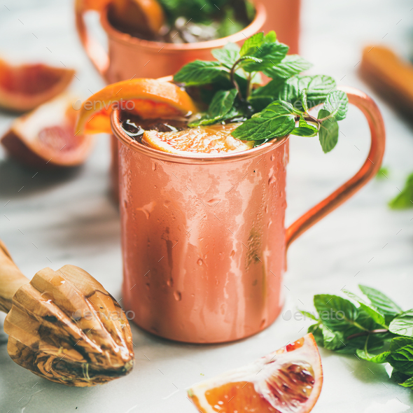 Blood orange Moscow mule alcohol cocktails, square crop - Stock Photo - Images