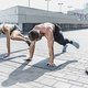 Fit fitness woman and man doing fitness exercises outdoors at city - PhotoDune Item for Sale