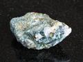 Chrysoberyl crystals in raw beryl rock on black - PhotoDune Item for Sale
