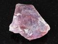 rough pink Flint stone (Chalcedony) on black - PhotoDune Item for Sale