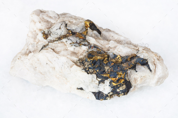 raw Chalcopyrite crystals in quartz rock on white - Stock Photo - Images