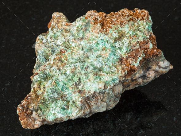 rough Pyrophyllite stone on black - Stock Photo - Images