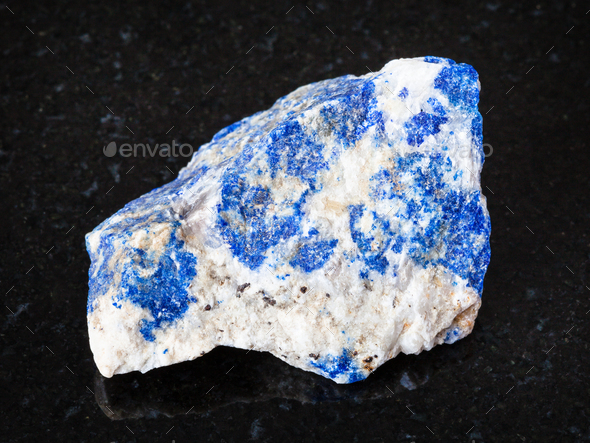 raw Lazurite (Lapis Lazuli) stone on black - Stock Photo - Images