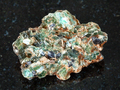 green beryl crystals in rough rock on black - PhotoDune Item for Sale